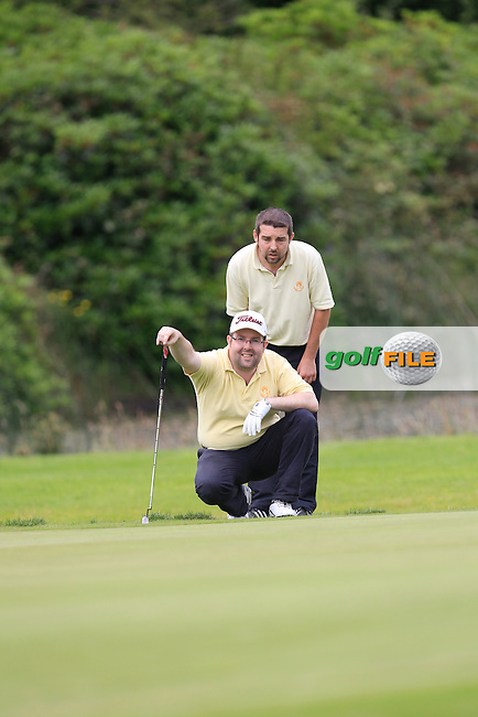 Stephen Quigley and Shane Quigley (Thurles) on the 13th green during the Final round of the Munster section of the AIG Pierce Purcell Shield at East Clare Golf Club on Sunday 19th July 2015.<br /> Picture:  Golffile | Thos Caffrey