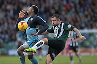 Gozie Ugwu of Wycombe Wanderers blocks the clearance of Peter Hartley of Plymouth Argyle during the Sky Bet League 2 match between Plymouth Argyle and Wycombe Wanderers at Home Park, Plymouth, England on 30 January 2016. Photo by Mark  Hawkins / PRiME Media Images.