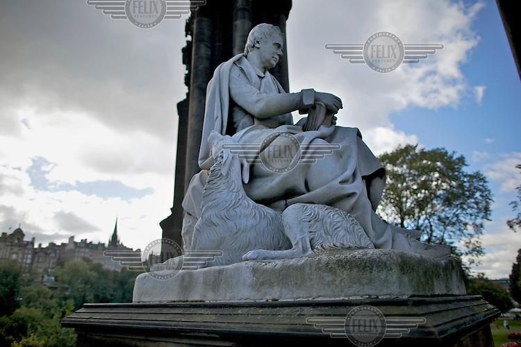 A statue of Sir Walter Scott beneath the Scott Monument in Edinburgh city centre.