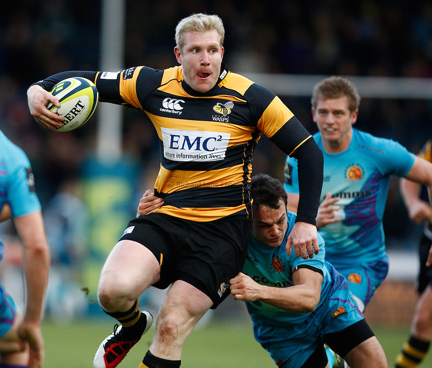 Photo: Richard Lane/Richard Lane Photography. London Wasps v Exeter Chiefs. LV= Cup. 28/12/2012. Wasps' Lee Robinson  attacks.