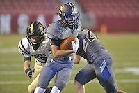 NWA Democrat-Gazette/MICHAEL WOODS • @NWAMICHAELW<br /> Shiloh Christian receiver Tyler Roth tries to shake Charleston defender Colton McDonald as he runs for a gain Tuesday September 1, 2015 at Razorback Stadium in Fayetteville.