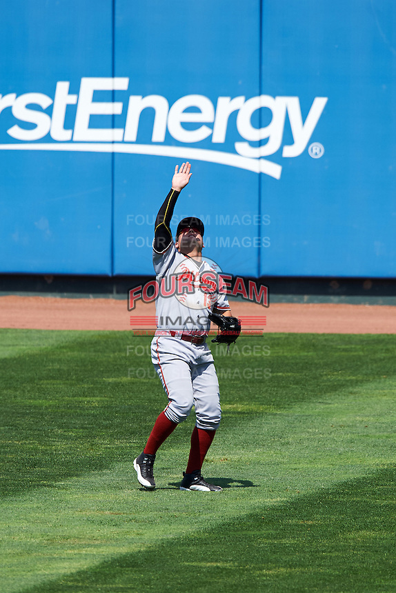 Altoona Curve right fielder Stetson Allie (13) uses his hand to shield the sun on a fly ball during a game against the Erie SeaWolves on July 10, 2016 at Jerry Uht Park in Erie, Pennsylvania.  Altoona defeated Erie 7-3.  (Mike Janes/Four Seam Images)
