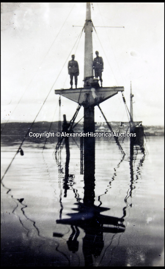 BNPS.co.uk (01202 558833)<br /> Pic: AlexanderHistoricalAuctions/BNPS<br /> <br /> Two crews members perched on the bow of the sunken German destroyer Bernd von Arnim<br /> <br /> Fascinating images which provide a snapshot of life on a German U-Boat have been unearthed.<br /> <br /> Interestingly, the photographs give us an insight into joyous occasions on the U-976 destroyer including alcohol fuelled parties and gatherings in the mess hall.<br /> <br /> The photo album which was collated by First Officer Lieutenant Wilhelm Hinrichs has now emerged for auction and is tipped to sell for £1,200.<br /> <br /> The U-976 was sunk on March 25, 1944, just a few months before the Normandy landings, near St Nazaire in France by gunfire from two British Mosquito fighter-bombers.