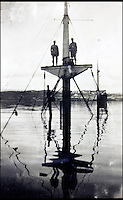 BNPS.co.uk (01202 558833)<br /> Pic: AlexanderHistoricalAuctions/BNPS<br /> <br /> Two crews members perched on the bow of the sunken German destroyer Bernd von Arnim<br /> <br /> Fascinating images which provide a snapshot of life on a German U-Boat have been unearthed.<br /> <br /> Interestingly, the photographs give us an insight into joyous occasions on the U-976 destroyer including alcohol fuelled parties and gatherings in the mess hall.<br /> <br /> The photo album which was collated by First Officer Lieutenant Wilhelm Hinrichs has now emerged for auction and is tipped to sell for &pound;1,200.<br /> <br /> The U-976 was sunk on March 25, 1944, just a few months before the Normandy landings, near St Nazaire in France by gunfire from two British Mosquito fighter-bombers.