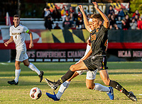 COLLEGE PARK, MD - NOVEMBER 03: Justin Harris #20 of Maryland and Carlos Tellez #6 of Michigan challenge for the ball during a game between Michigan and Maryland at Ludwig Field on November 03, 2019 in College Park, Maryland.
