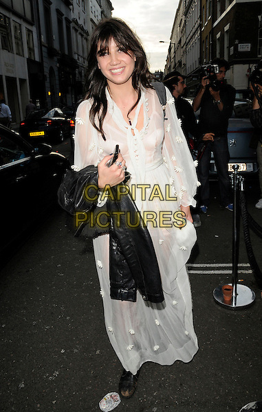 DAISY LOWE .At the opening of the Acne London Studio, Dover Street, London, England, UK, July 15th 2010..full length white long maxi dress sheer see thru though flowers applique sleeves black boots .CAP/CAN.©Can Nguyen/Capital Pictures.