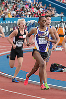 Blue Springs Stephen Mugeche runs the 1600 at the 2015 Kansas Relays.