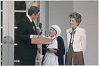 U.S. President Ronald Reagan and First Lady Nancy Reagan present Mother Teresa with the Medal of Freedom at a White House Ceremony on June 20, 1985.<br /> Credit: White House via CNP /MediaPunch
