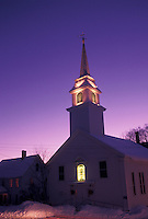 Vermont, VT, The church steeple in the scenic village of East Corinth illuminated at night in the winter.