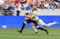 Houston, TX - Friday December 11, 2016: Ian Harkes (16) of the Wake Forest Demon Deacons and Foster Langsdorf (2) of the Stanford Cardinal battle for control of a loose ball at the NCAA Men's Soccer Finals at BBVA Compass Stadium in Houston Texas.