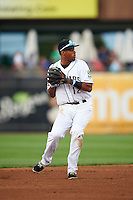 Kane County Cougars shortstop Dawel Lugo (12) throws to first during a game against the Great Lakes Loons on August 13, 2015 at Fifth Third Bank Ballpark in Geneva, Illinois.  Great Lakes defeated Kane County 7-3.  (Mike Janes/Four Seam Images)