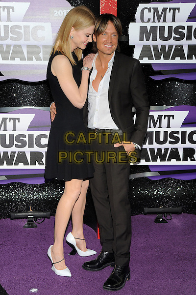 Nicole Kidman, Keith Urban<br /> 2013 CMT Music Awards held at Bridgestone Arena, Nashville, Tennessee, USA.<br /> June 5th, 2013<br /> full length black sleeveless dress white shoes suit  profile hand on chest married husband wife <br /> CAP/ADM/RP<br /> &copy;Ryan Pavlov/AdMedia/Capital Pictures