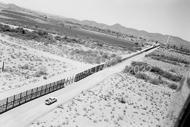 Lukeville, Arizona<br /> May 5, 2008<br /> <br /> Just west of Lukeville new vehicle barrier and fencing is being constructed on the US/Mexican border. <br /> <br /> Although new roads, fence and vehicle barrier have been put in place along the US/Mexican border - Arizona illegal traffic is still very heavy in the Tucson sector.