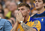 A Clare fan reacts late on during their All-Ireland semi-final against Galway at Croke Park. Photograph by John Kelly.