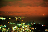 Rio de Janeiro, Brazil. The Sugarloaf and Guanabara Bay at night with the red of the setting sun.