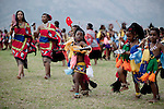 LUDZIDZINI, SWAZILAND - AUGUST 30: Young girls dance at a traditional Reed dance ceremony at the stadium at the Royal Palace on August 30, 2009, in Ludzidzini, Swaziland. About 80.000 virgins from all over the country attended this yearly event, the biggest in Swazi culture. It was founded to celebrate the beauty of Swazi women and girls. King Mswati III, and absolute monarch, was born in 1968 and he has 14 wives and many children. The king danced with his men in front of the 80.000 girls. Many of the girls hope to get noticed by the king and to be chosen as a future wife, a ticket from poverty and into a life of privilege and luxury. The country is one of the poorest in the world and it is struggling with a high prevalence of HIV-Aids and severe poverty. (Photo by: Per-Anders Pettersson)...