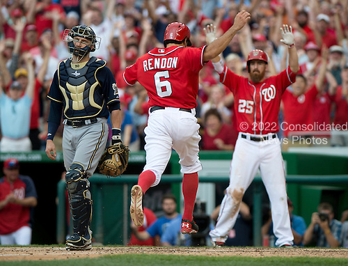 Washington Nationals third baseman Anthony Rendon (6) is congratulated by first baseman Adam LaRoche (25) as he scores the game-winning run on right fielder Jayson Werth's (28) double in the ninth inning against the Milwaukee Brewers at Nationals Park in Washington, D.C. on Sunday, July 20, 2014.  Brewers catcher Jonathan Lucroy (20) walks away at left.  The Nationals won the game 5 - 4.  <br /> Credit: Ron Sachs / CNP