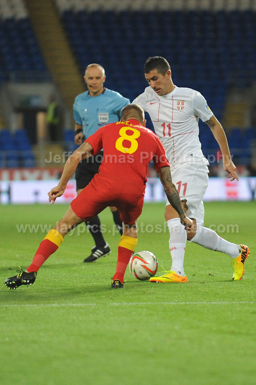 Kolarov of Serbia and Manchester City battles against Craig Bellamy of Wales and Cardiff City during the Wales v Serbia FIFA World Cup 2014 Qualifier match at Cardiff City Stadium, Cardiff, Wales -Tuesday 10th Sept 2014. All images are the copyright of Jeff Thomas Photography-07837 386244-www.jaypics.photoshelter.com