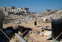 Al Tufa'ah, Gaza Strip, 22 Nov 2009.Almost a year after the 'Cast Lead' israeli operation, inhabitants are still cleaning up the rubles of their homes, trying to recycle all possible material as Gaza is still under complete blockade from Israel. Hundreds of houses, farms and factories had been destroyed and bulldozed over by the Israeli army, flattening approximately an area 10km square, ruining countless families, left resourceless in what amounts to collective punishment..
