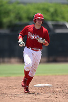 GCL Phillies catcher Joel Fisher (15) runs the bases after hitting his first professional home run during a game against the GCL Pirates on June 26, 2014 at the Carpenter Complex in Clearwater, Florida.  GCL Phillies defeated the GCL Pirates 6-2.  (Mike Janes/Four Seam Images)