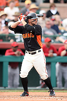 Cody Ross #13 of the San Francisco Giants bats against the Arizona Diamondbacks in the first spring training game of the season at Scottsdale Stadium on February 25, 2011  in Scottsdale, Arizona. .Photo by:  Bill Mitchell/Four Seam Images.