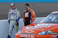 Apr 19, 2007; Avondale, AZ, USA; Nascar Nextel Cup Series driver Jimmie Johnson (48) walks with Tony Stewart (20) during qualifying for the Subway Fresh Fit 500 at Phoenix International Raceway. Mandatory Credit: Mark J. Rebilas