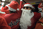 SantaCon Father Christmas travel around London on tube train. London UK 2015.