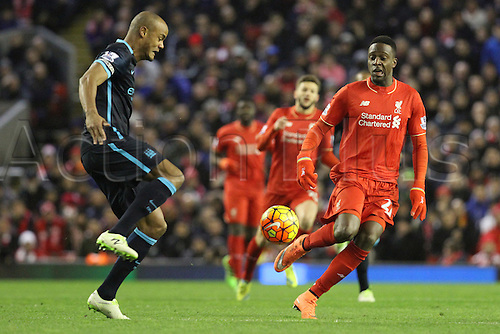 02.03.2016. Anfield Stadium, Liverpool, England. Barclays Premier League. Liverpool versus Manchester City. Vincent Company of Manchester City clears the ball under pressure from Divock Origi of Liverpool
