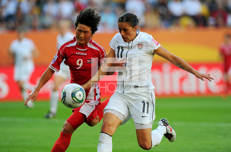 Alex Krieger (r) of Team USA and Ra Un Sim of Team North Korea during the FIFA Women's World Cup at the FIFA Stadium in Dresden, Germany on June 28th, 2011.
