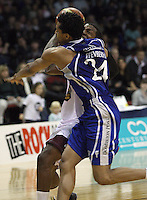 Saints import Mike Efevberha fouls Heat import Mychal Green during the National Basketball League match Wellington Saints and Harbour Heat at TSB Bank Arena, Wellington, New Zealand on Saturday 13 June 2009. Photo: Dave Lintott / lintottphoto.co.nz
