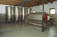 "The Kiralyudvar winery in Tarcal: inside the wine making facility: stainless steel fermentation tanks and the wine press. Kiralyudvar (meaning ""King's Court"")is run by Istvan Szepsy, considered maybe the best winemaker in Tokaj. he also makes Tokaj under his own name.  Credit Per Karlsson BKWine.com"
