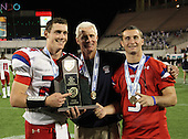 Manatee Hurricanes quarterback Cord Sandberg #24, brother Chase Sandberg #9 - who did not play due to injury - pose with their father Chuck Sandberg (center) after the Florida High School Athletic Association 7A Championship Game at Florida's Citrus Bowl on December 16, 2011 in Orlando, Florida.  Manatee defeated First Coast 40-0.  (Photo By Mike Janes Photography)