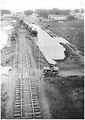 Derailment at Espanola just north of station grounds.  Road had given way after a heavy rain. All passenger cars overturned, but<br /> D&amp;RG  Espanola, NM  Taken by Peterson, - 1921