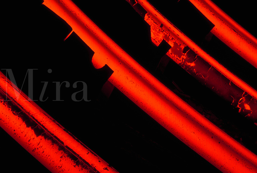 Close-up of red-hot steel bars