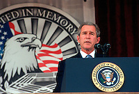 Oct 11, 2001, Washington, DC, United States<br /> <br /> President George W. Bush addresses the audience during the Pentagon memorial service on Oct. 11, 2001, in honor of those who perished in the terrorist attack on the building one-month earlier.  Bush, Secretary of Defense Donald H. Rumsfeld and Chairman of the Joint Chiefs of Staff Gen. Richard B. Myers, U.S. Air Force, eulogized the 184 persons killed when a terrorist hijacked airliner was purposely crashed into the southwest face of the building on Sept. 11, 2001.