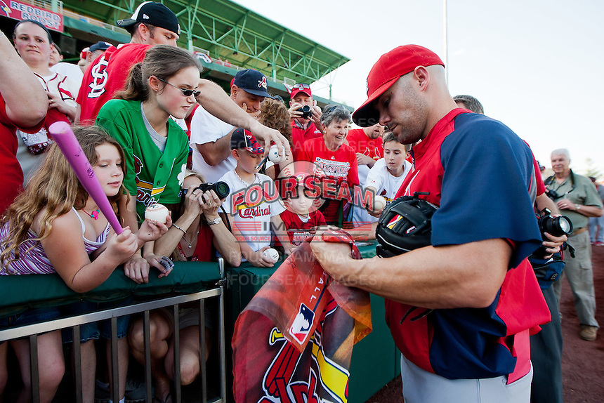 Skip Schumaker (55) of the St. Louis Cardinals signs autographs for fans prior to a game against the Springfield Cardinals at Hammons Field on April 2, 2012 in Springfield, Missouri. (David Welker/Four Seam Images)