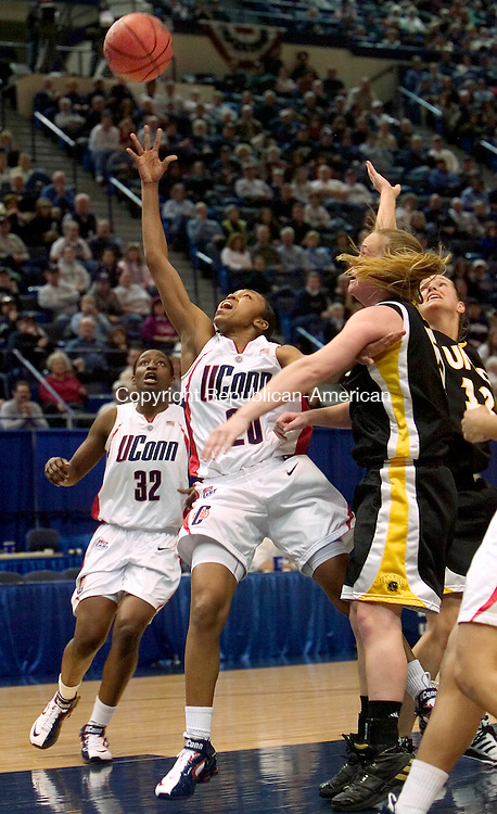 HARTFORD, CT. 18 March 2007-031807SV10--#20 Renee Montogomery of UConn puts up an off balance shot against UMBC during the first round of NCAA action at the Civic Center in Hartford Sunday.<br /> Steven Valenti Republican-American
