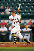 Bradenton Marauders left fielder Logan Hill (25) follows through on a swing during a game against the Clearwater Threshers on April 18, 2017 at LECOM Park in Bradenton, Florida.  Clearwater defeated Bradenton 4-2.  (Mike Janes/Four Seam Images)