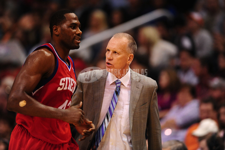Dec. 28, 2011; Phoenix, AZ, USA; Philadelphia 76ers head coach Doug Collins (right) talks with forward Elton Brand during game against the Phoenix Suns at the US Airways Center. The 76ers defeated the Suns 103-83. Mandatory Credit: Mark J. Rebilas-USA TODAY Sports