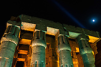 Egypt. Luxor Temple is a large temple complex founded in 1400 BC. Large columns with the moon as background.