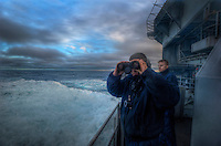 101221-N-7981E-842 PACIFIC OCEAN (Dec. 21, 2010)- Seaman Steel Thomas, assigned to Deck Department's 3rd Division, and Boatswain's Mate 3rd Class Shane Maurin, assigned to Deck Department's 1st Division, scan the sea and skies for threats while standing watch as aft lookouts on the fantail of the aircraft carrier USS Carl Vinson (CVN 70). Carl Vinson and Carrier Air Wing (CVW) 17 are currently on a deployment to the 7th and 5th Fleet areas of responsibility. (U.S. Navy photo illustration by Mass Communication Specialist 2nd Class James R. Evans / RELEASED)