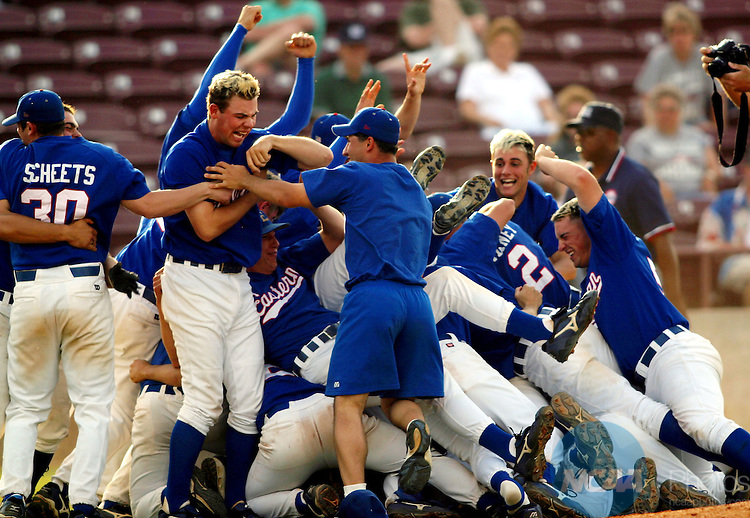 28 MAY 2002:  Eastern Connecticut State University pitcher Thomas Spirito (blond hair, left) injures himself during the pile up celebration after defeating Marietta College during the Division 3 Men's Baseball Championship held at Fox Cities Stadium in Grand Chute, WI.  ECSU defeated Marietta 8-0 for the national title.  Allen  Fredrickson/NCAA Photos