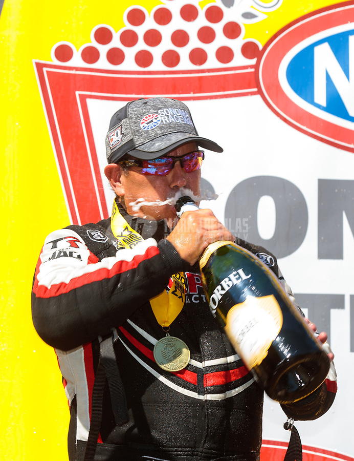 Jul 28, 2019; Sonoma, CA, USA; NHRA top fuel driver Billy Torrence sprays champagne as he celebrates after winning the Sonoma Nationals at Sonoma Raceway. Mandatory Credit: Mark J. Rebilas-USA TODAY Sports