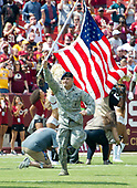 A member of the United States Air Force runs onto the field carrying the American Flag prior to the Philadelphia Eagles against the Washington Redskins game at FedEx Field in Landover, Maryland on Sunday, September 10, 2017.  The Eagles won the game 30 - 17.<br /> Credit: Ron Sachs / CNP