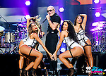 MIAMI, FL - NOVEMBER 07:  Recording artist Pitbull (C) performs onstage at iHeartRadio Fiesta Latina presented by Sprint at American Airlines Arena on November 7, 2015 in Miami, Florida.  (Photo by Alexander Tamargo/Getty Images for iHeartMedia) *** Local Caption *** Pitbull
