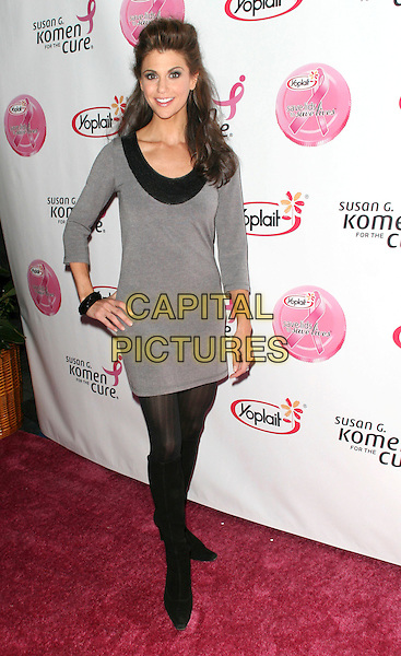 SAMANTHA HARRIS .Attending Concert for the 10th Anniversary Of Yoplait's Save the Lids To Save Lives For Susan G.Komen For the Cure, Los Angeles, California, USA, .10 October 2008..full length grey gray dress hand on hip black tights knee high boots .CAP/ADM/KB.©Kevan Brooks/Admedia/Capital PIctures
