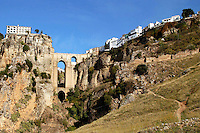 The town of Ronda, Andalusia, Spain, perched on both sides of the Tajo Gorge and joined by the New Bridge (Puente Nuevo) which was built in the late 18th century. Ref: 200211051342.<br />