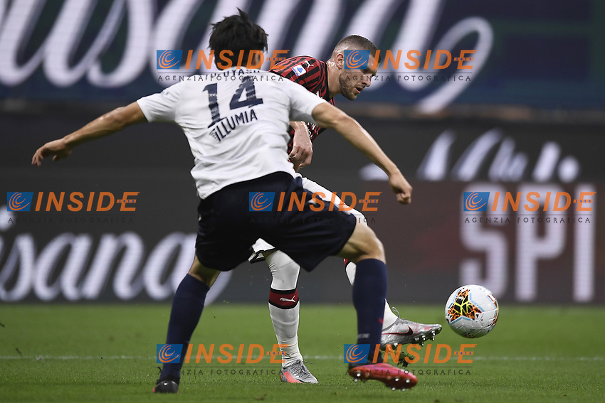 Takehiro Tomiyasu of Bologna FC and Ante Rebic of AC Milan compete for the ball during the Serie A football match between AC Milan and Bologna FC at stadio Giuseppe Meazza in Milano ( Italy ), July 18th, 2020. Play resumes behind closed doors following the outbreak of the coronavirus disease. <br /> Photo Image Sport / Insidefoto