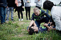Francisco Ventoso (ESP/Movistar) crashed out and awaits medical attention as someone from the team is comforting him.<br /> Ventoso apparently has a serious cut to the leg that was (reportedly) an injury due to falling on disc brakes... a controversial choice in the pro-peloton.<br /> <br /> 114th Paris-Roubaix 2016