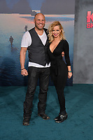 Randy Couture &amp; Mindy Robinson at the premiere for &quot;Kong: Skull Island&quot; at Dolby Theatre, Los Angeles, USA 08 March  2017<br /> Picture: Paul Smith/Featureflash/SilverHub 0208 004 5359 sales@silverhubmedia.com